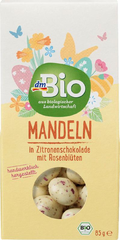 dmBio Mandeln geröstet in weißer Zitronenschokolade mit Rosenblüten