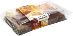 Biskuittörtchen mit 37,5 % Creme (Karamellgeschmack), mit Kakaopulver bestreut & Biskuitörtchen mit 50% Creme (Vanillegeschmack), mit Erdnüssen bestreut